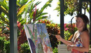 Artist Susanne Rikus paints on Maui